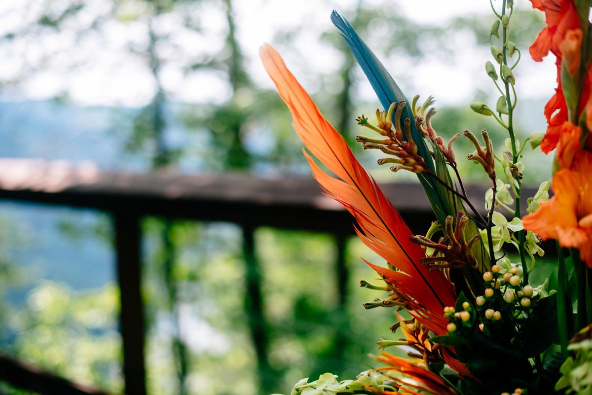parrot feathers wedding floral arrangement