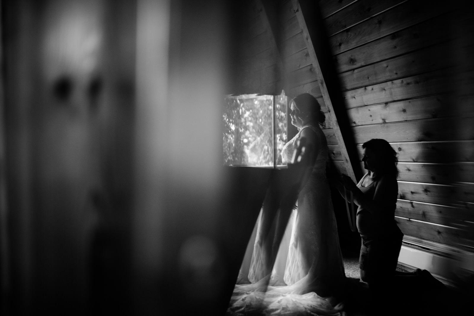 bride putting on wedding dress oberports wv photojournalism