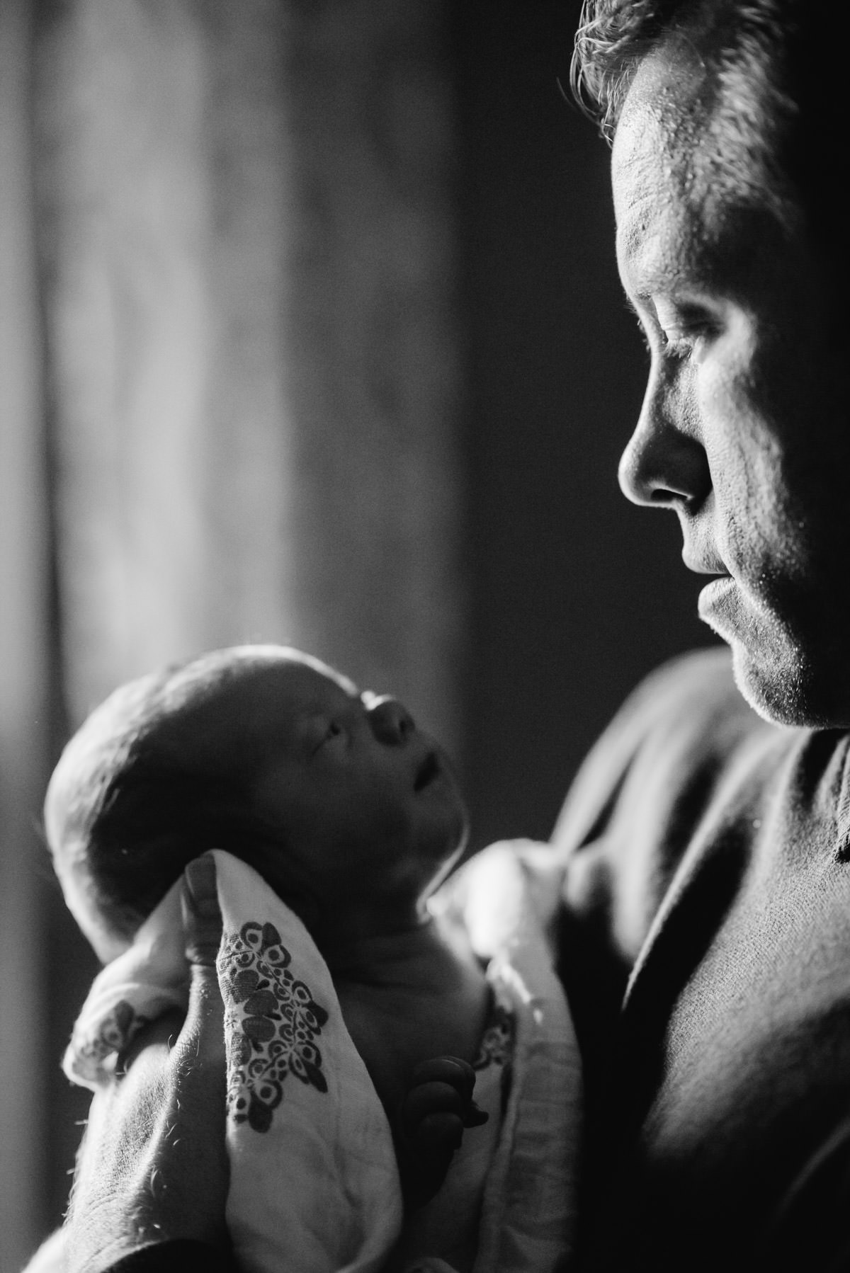 black and white newborn with dad photo by best wv photographers the oberports