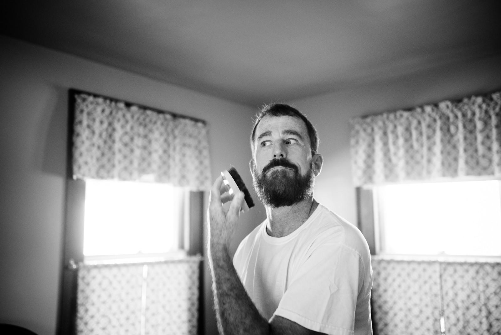 groom brushes beard
