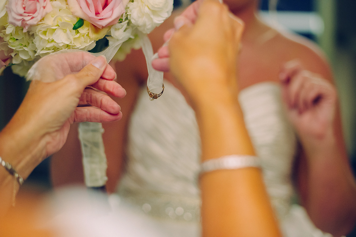 tying ring onto bouquet