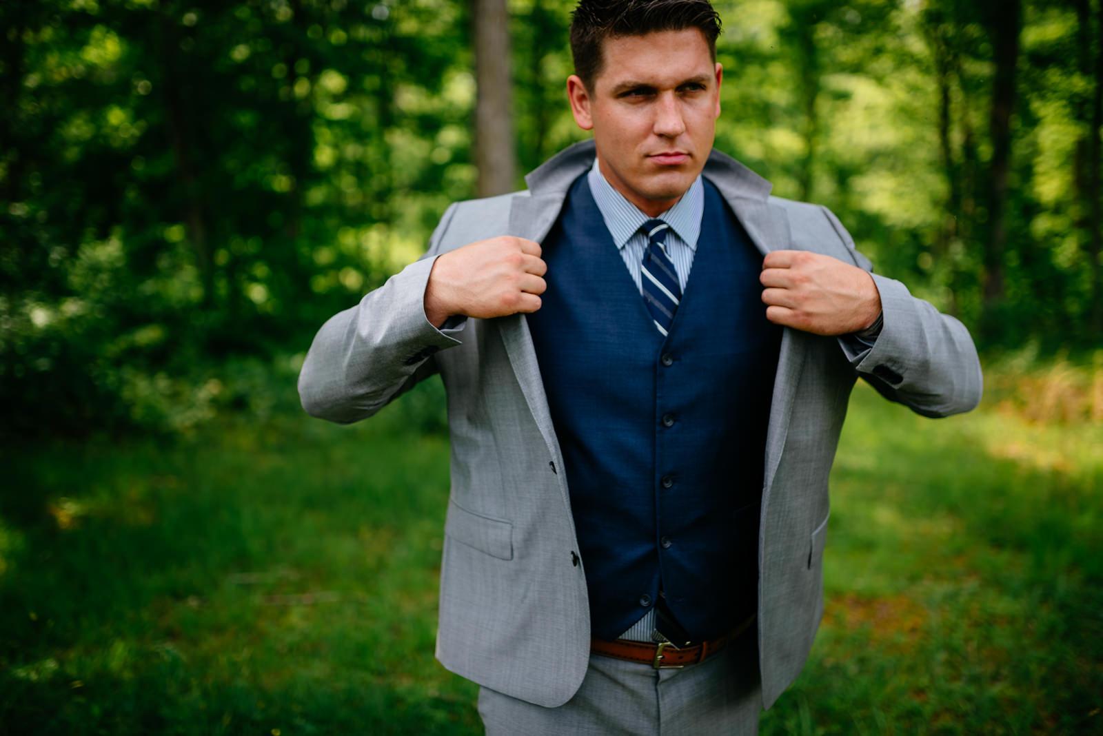 grrom putting on jacket fayetteville wv wedding