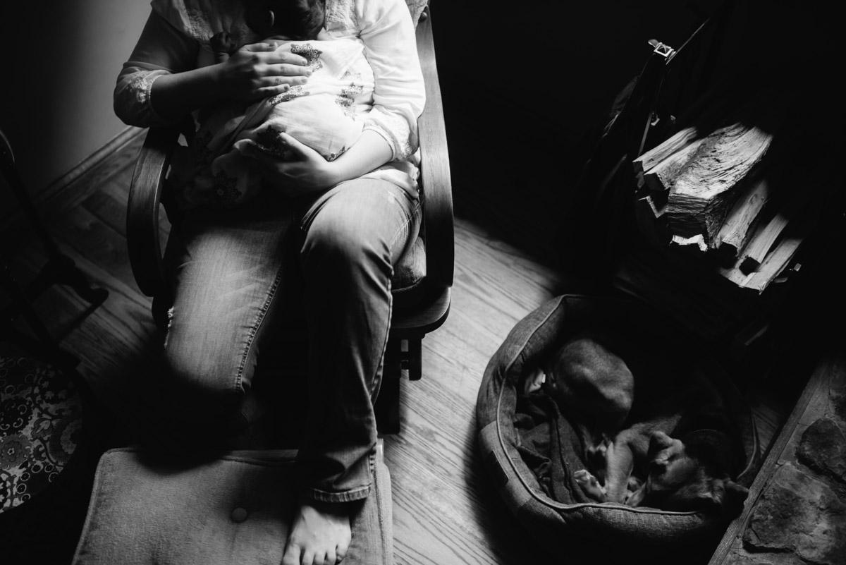 mom with newborn documentary style newborn photo