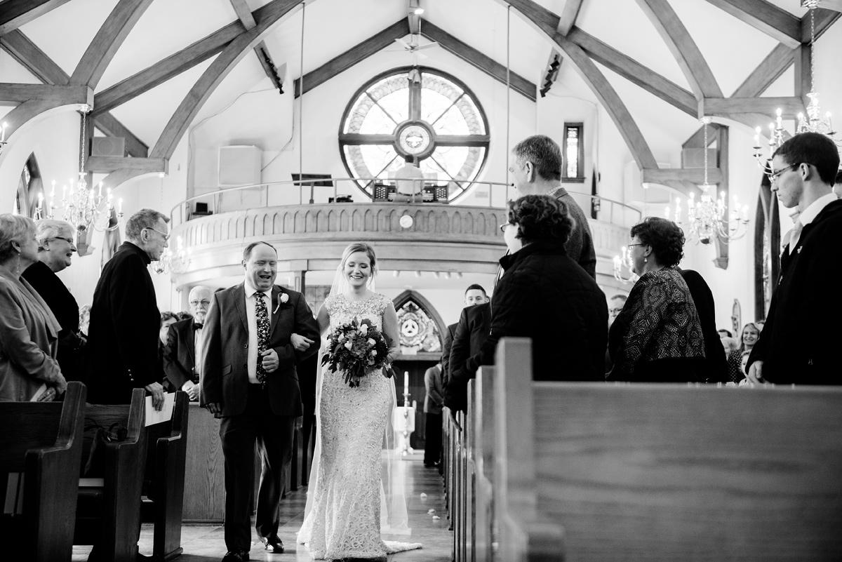 huntington wv winter wedding bride walking down aisle