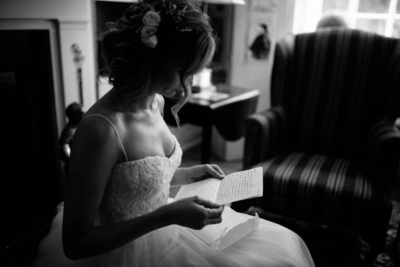bride reading letter on her wedding day