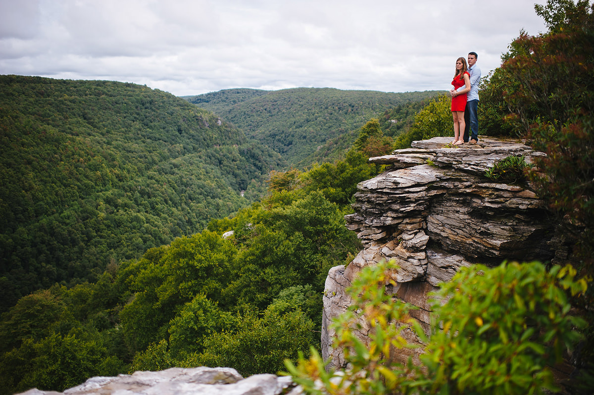 portrait of newly engaged couple on overlook at blackwater falls state park