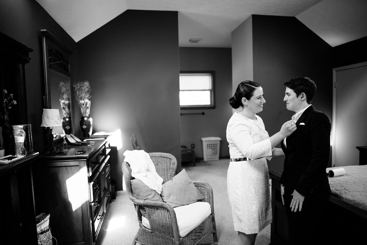 same sex couple getting ready together for wedding