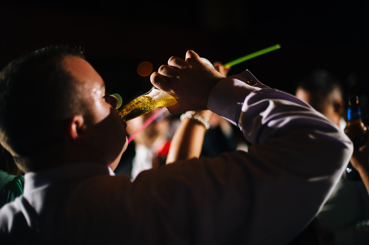 wedding reception drinking beer glowsticks by pittsburgh wedding photographers the oberports