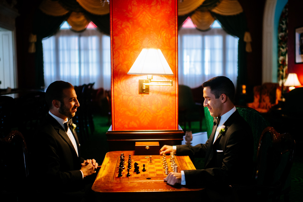 groomsmen playing chess at the lobby bar at the greenbrier