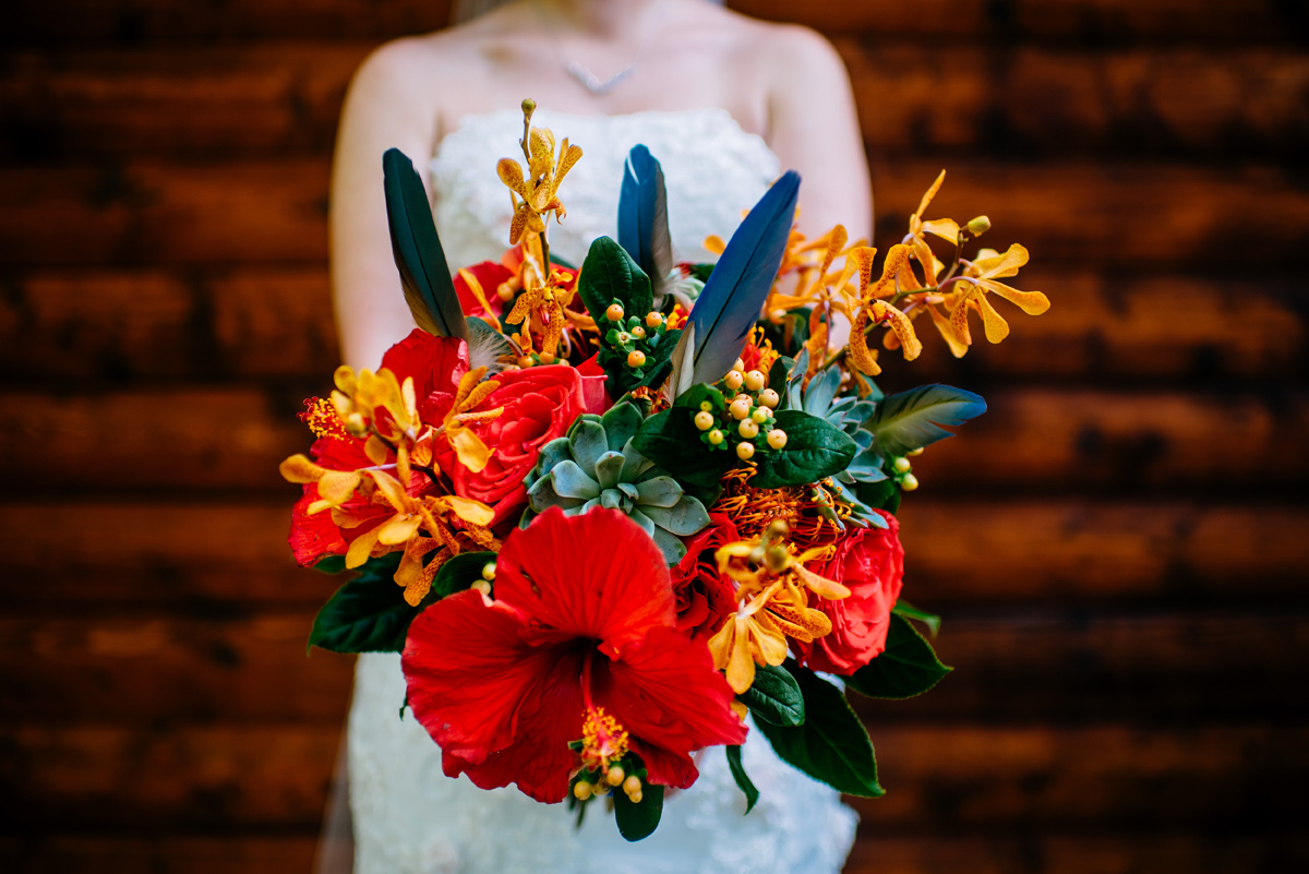 tropical bridal bouquet with parrot feathers and hibiscus flowers