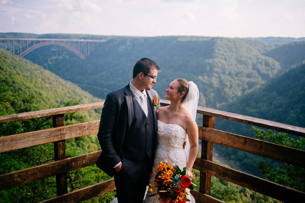bride and groom with new river gorge bridge