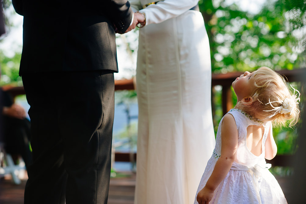 little girl watching mommy and daddy get married