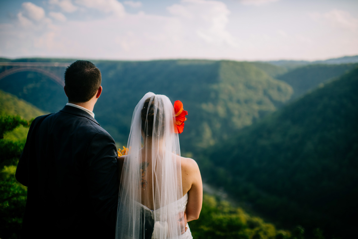 bride and groom overlook the new river gorge