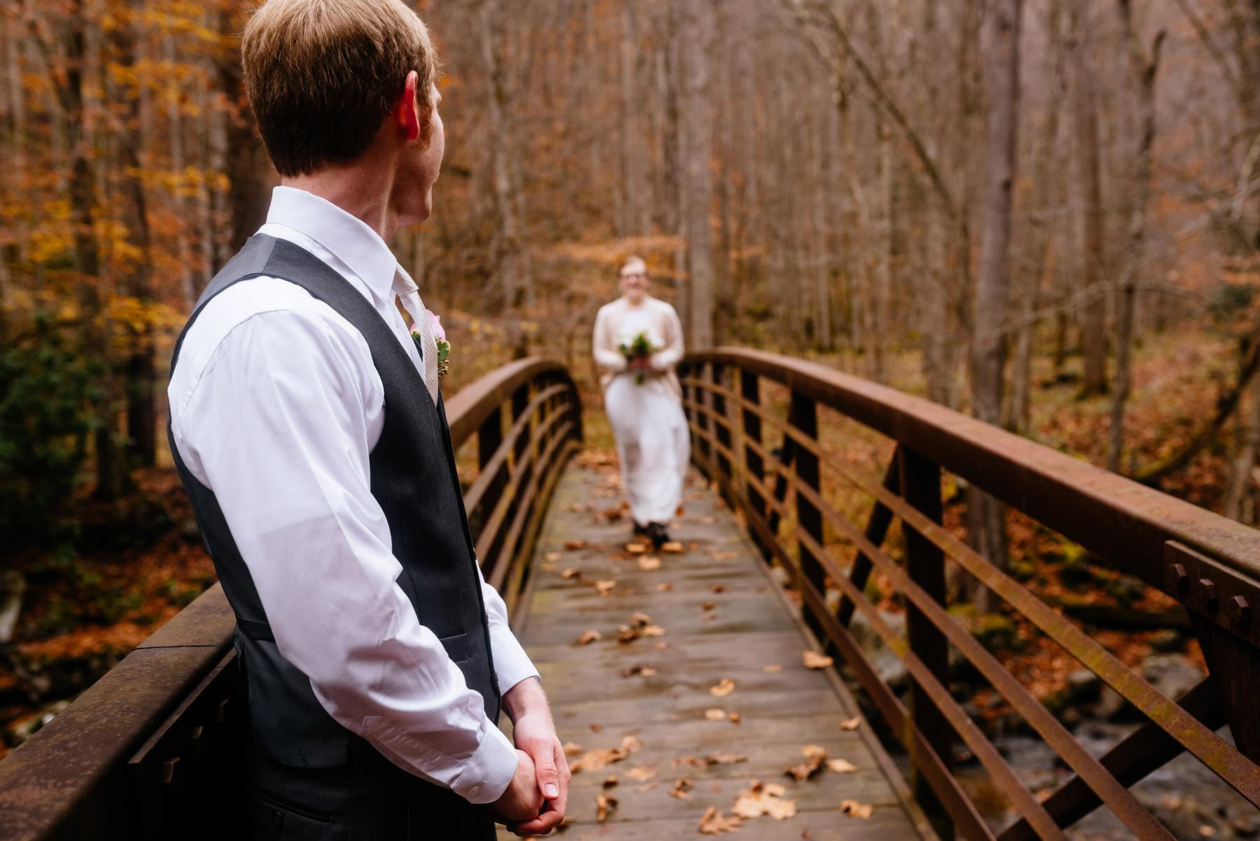 bride entering ceremony on bridge wv hiking elopement