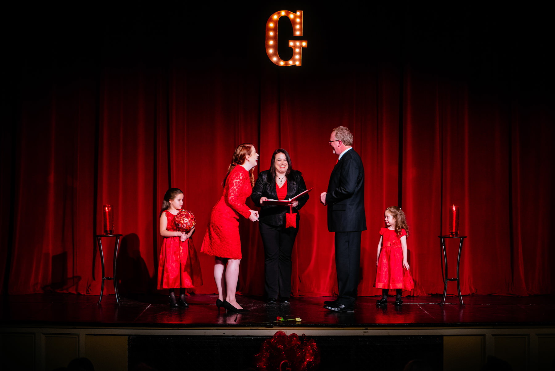 red theater curtain wedding ceremony