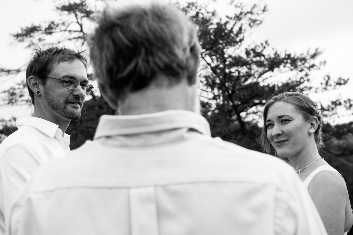 bride groom officiant ceremony outdoors