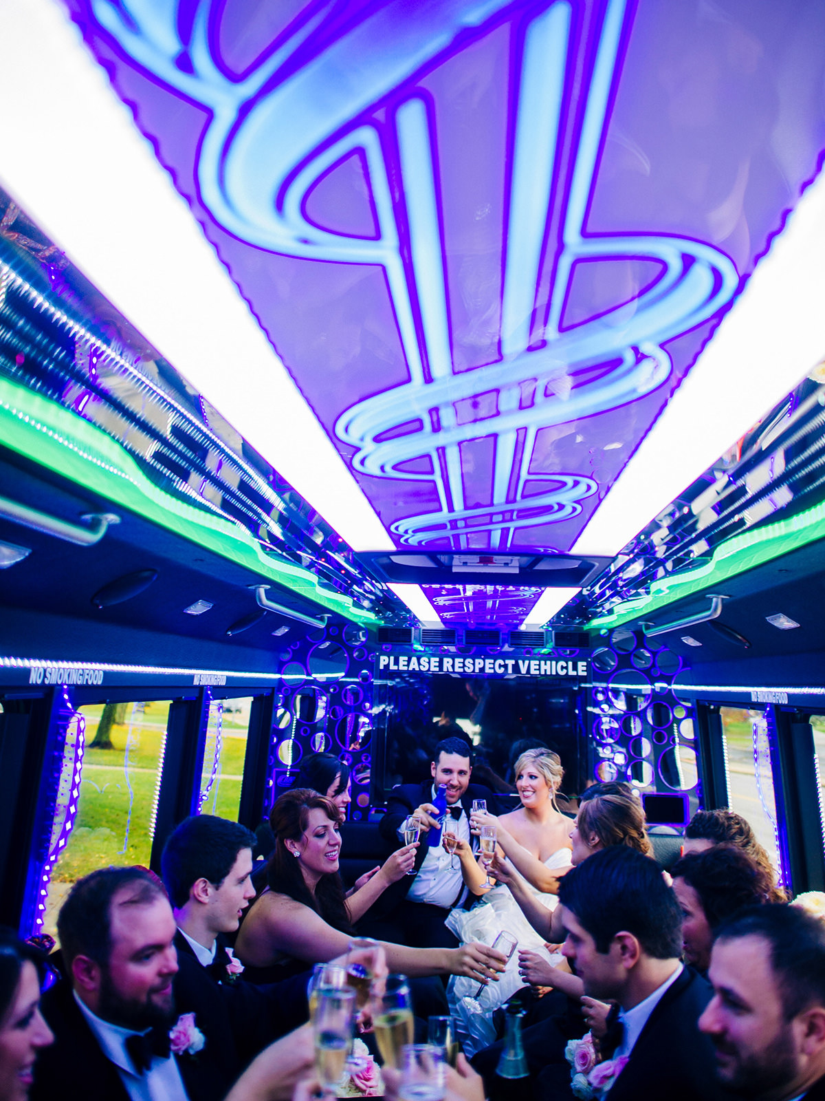wedding party drinking in party bus