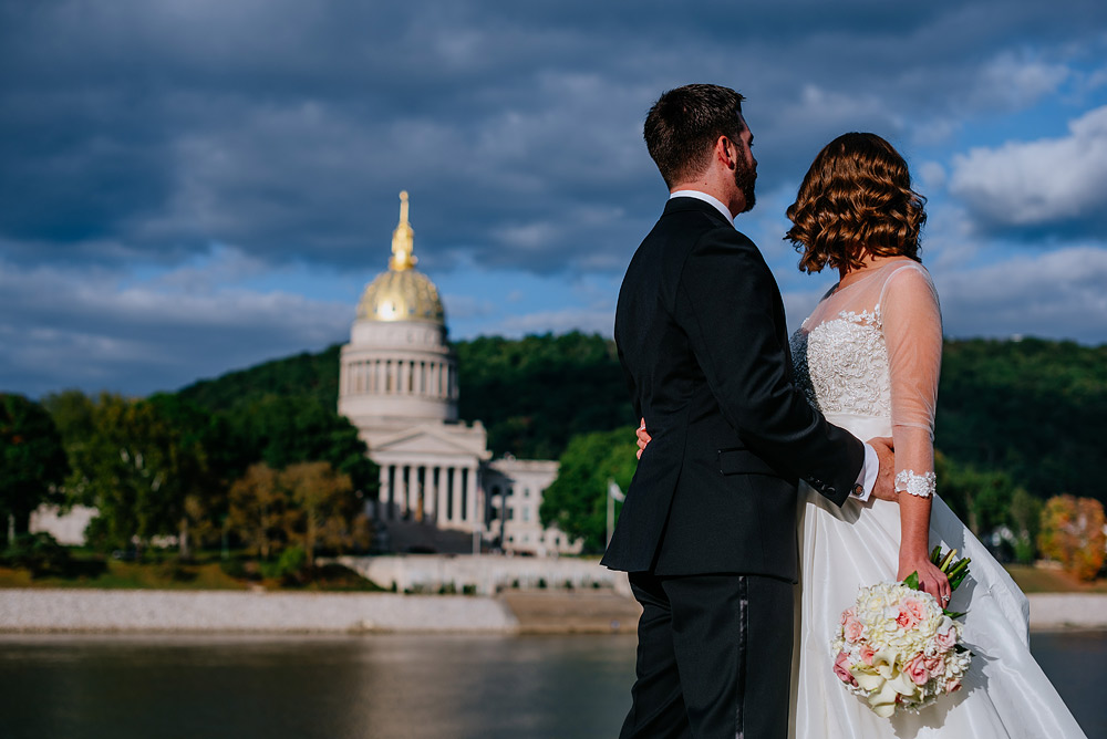 bride and groom overlook wv state capitol gold dome