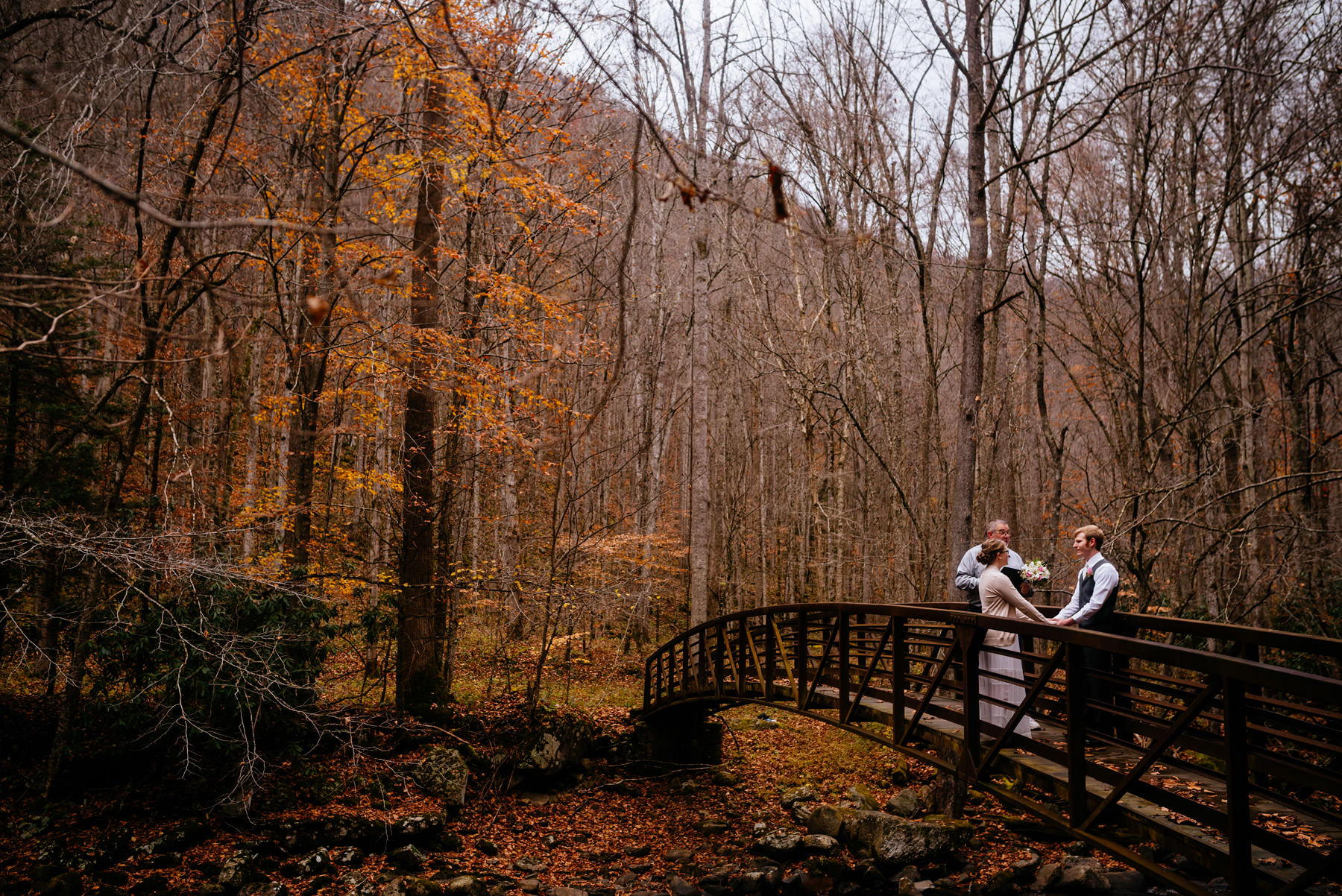ceremony on bridge autumn wv hiking elopement