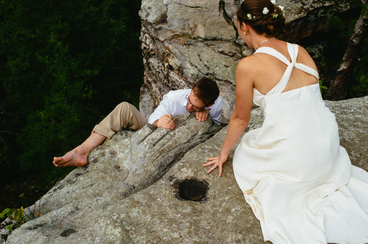 groom climbing rock during wedding new river gorge fayetteville photographers the oberports