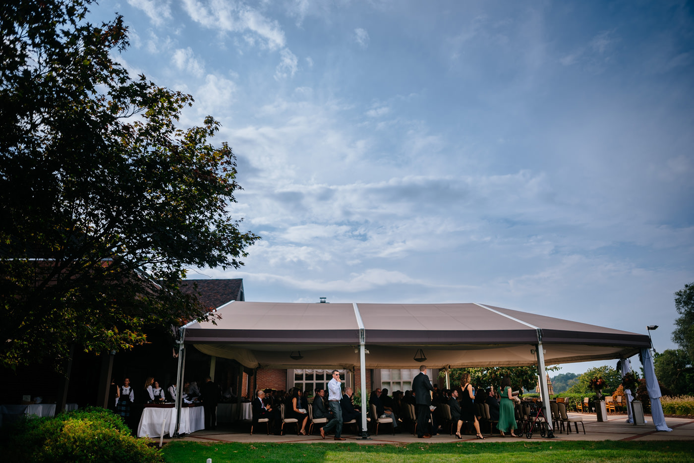 st clair country club wedding ceremony under tent