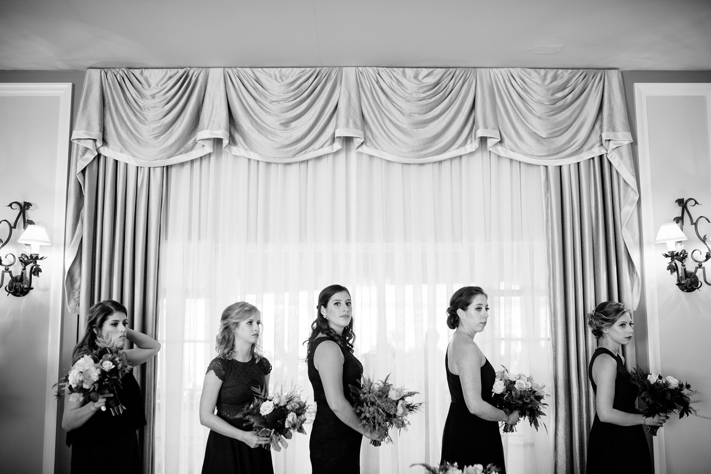 bridesmaids lined up for wedding ceremony