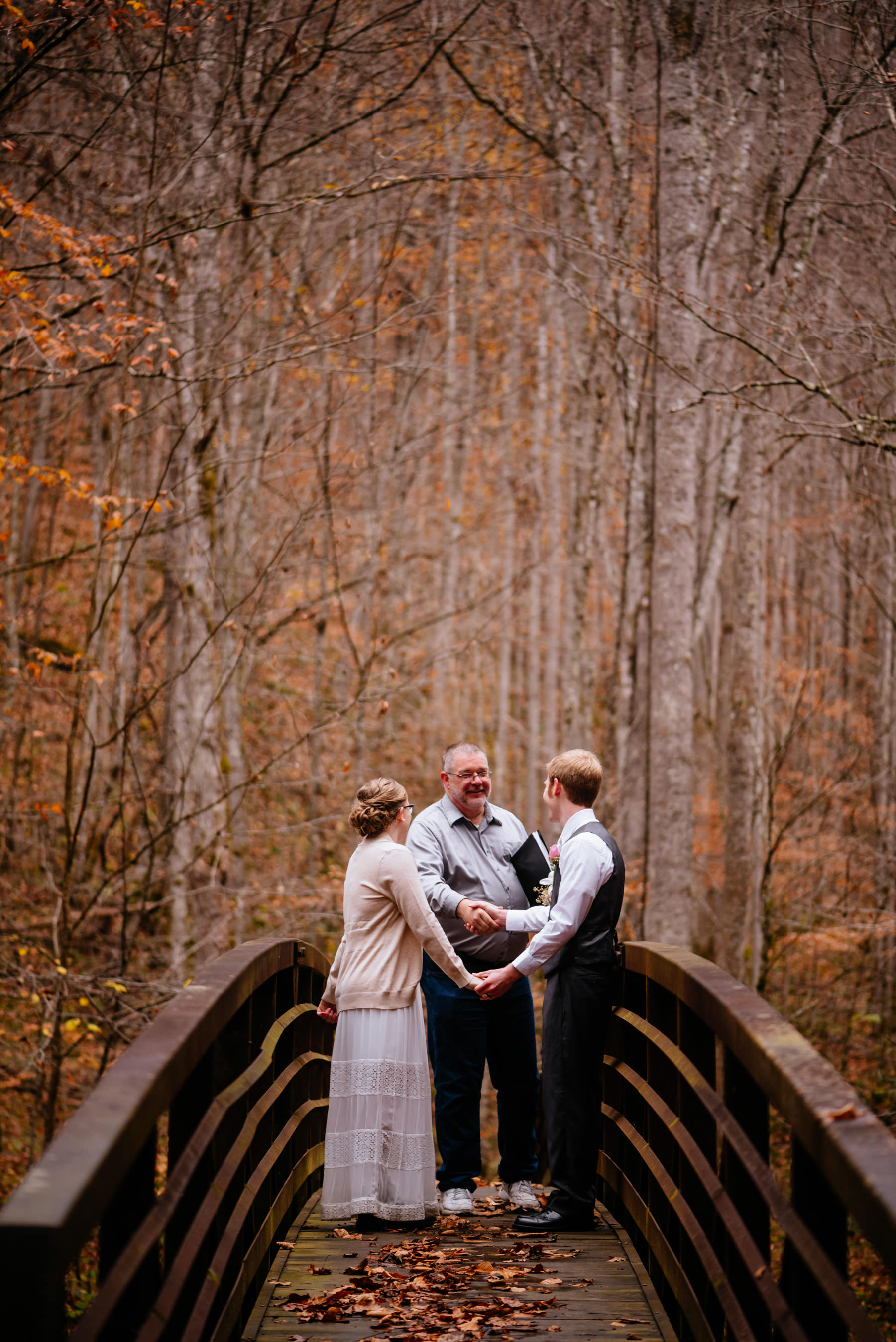 bride groom shaking hands with officiant wv autumn elopement