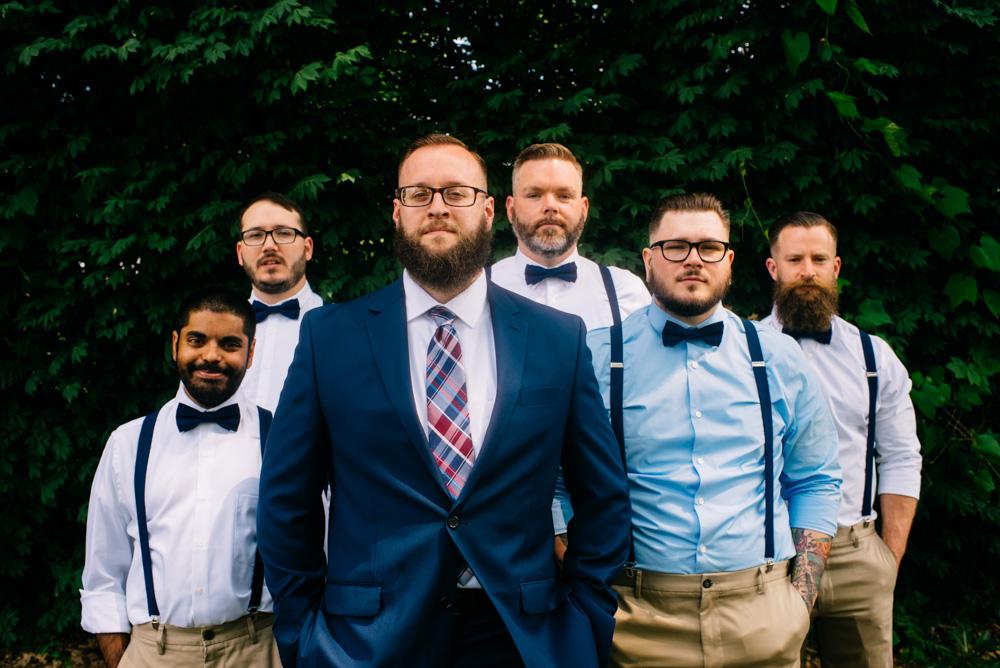 groomsmen with bowties and suspenders
