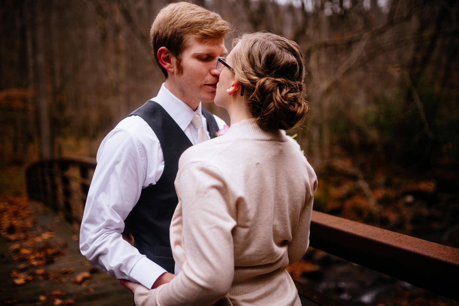 bride groom kissing autumn outdoor elopement