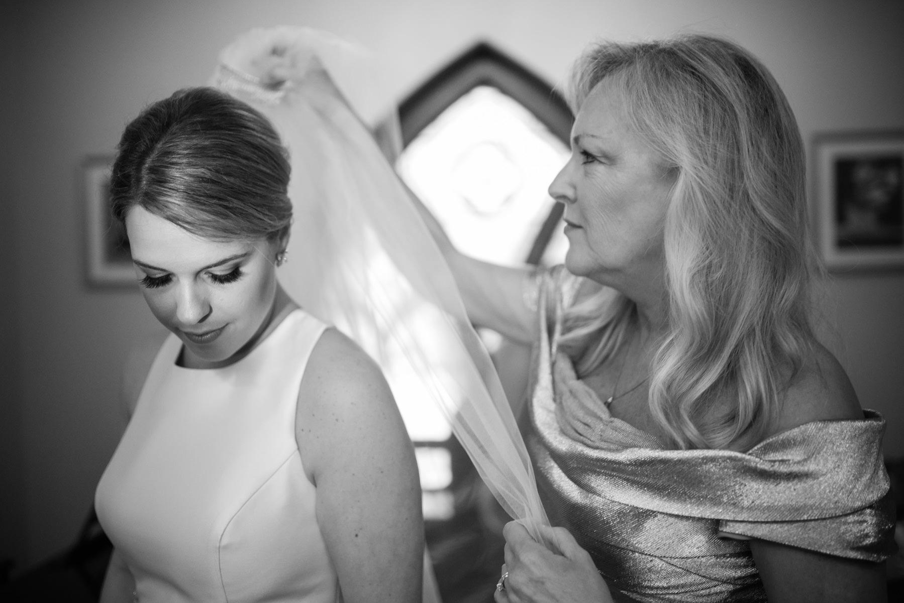 mom puts veil on daughter