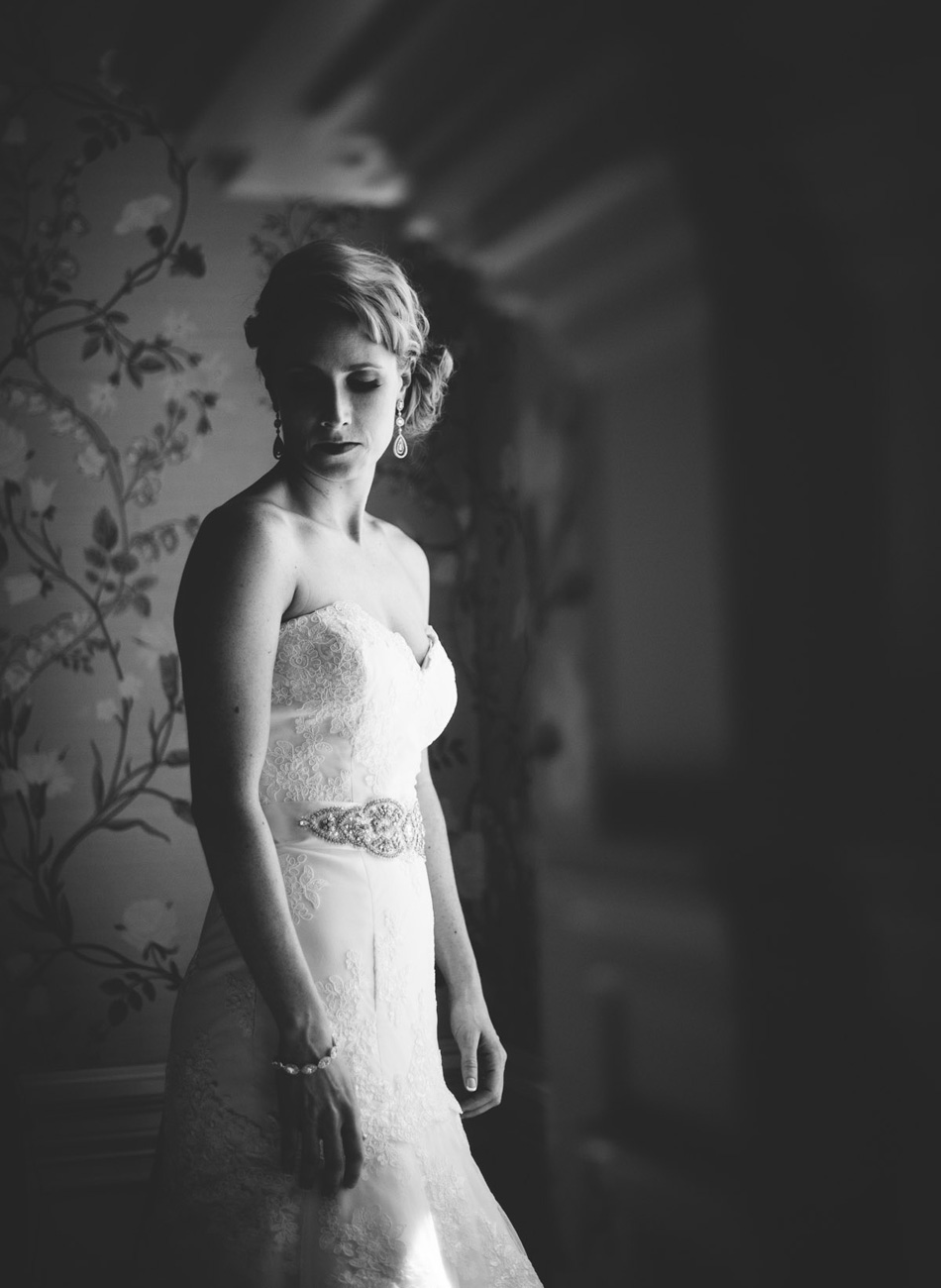 elegant bridal portrait by window black and white