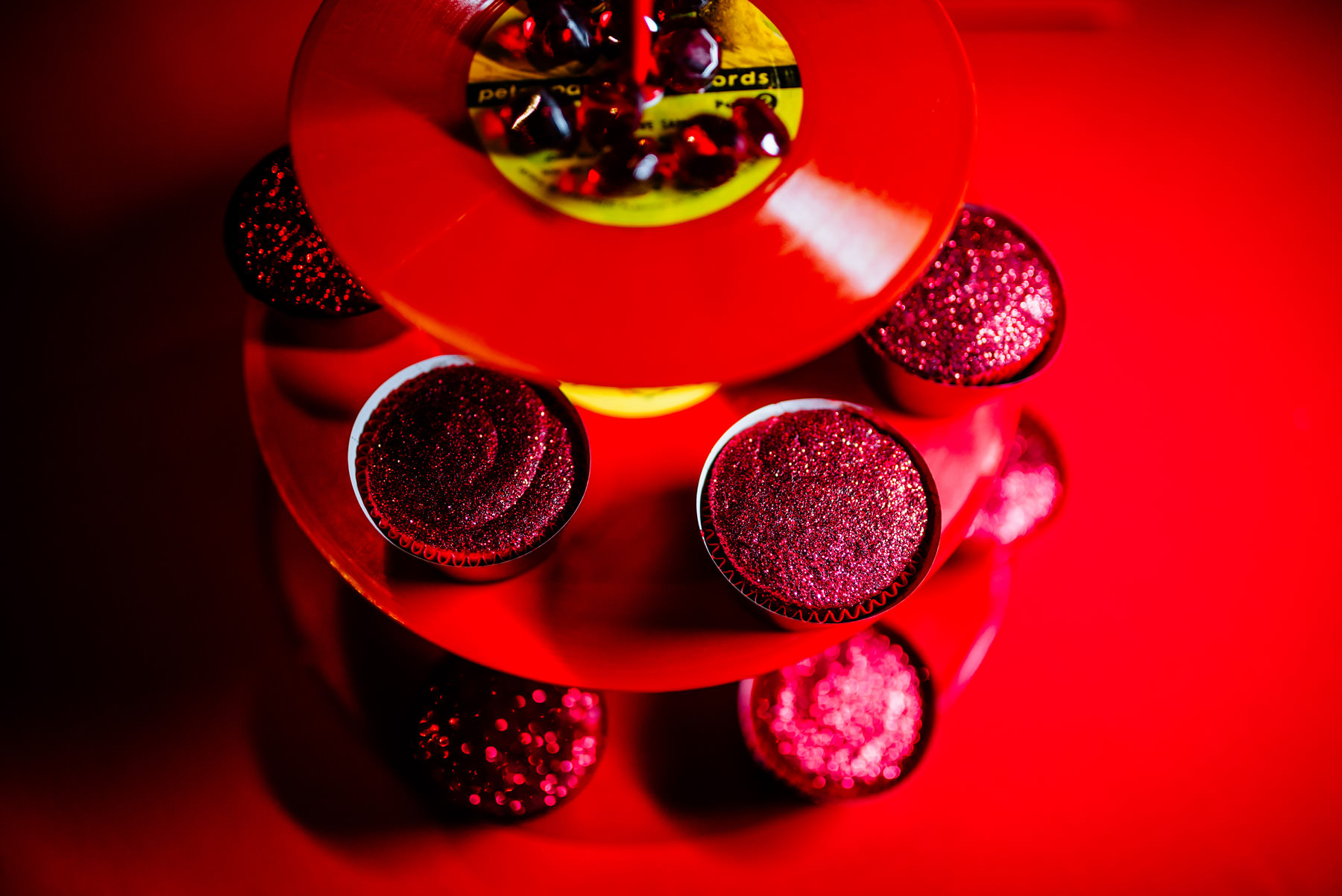 glittery cupcakes on a red lp cupcake stand
