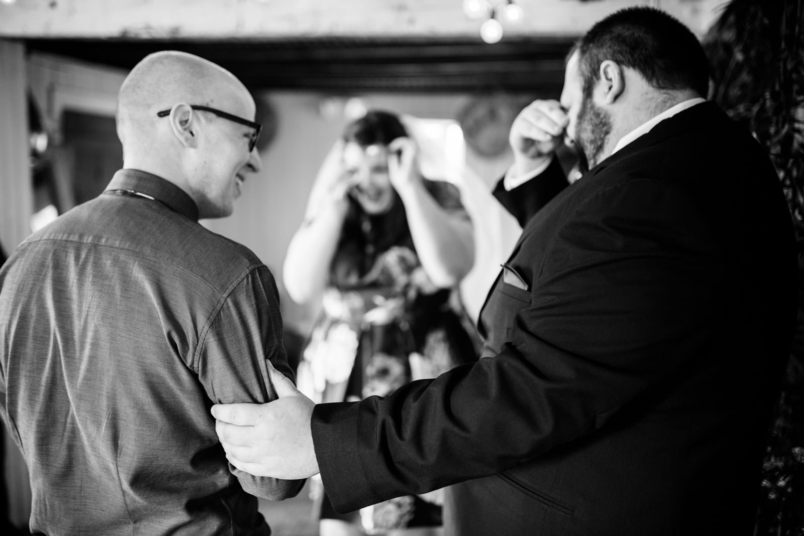 emotional brother in law with groom during ceremony in mushroom house terrain elopement