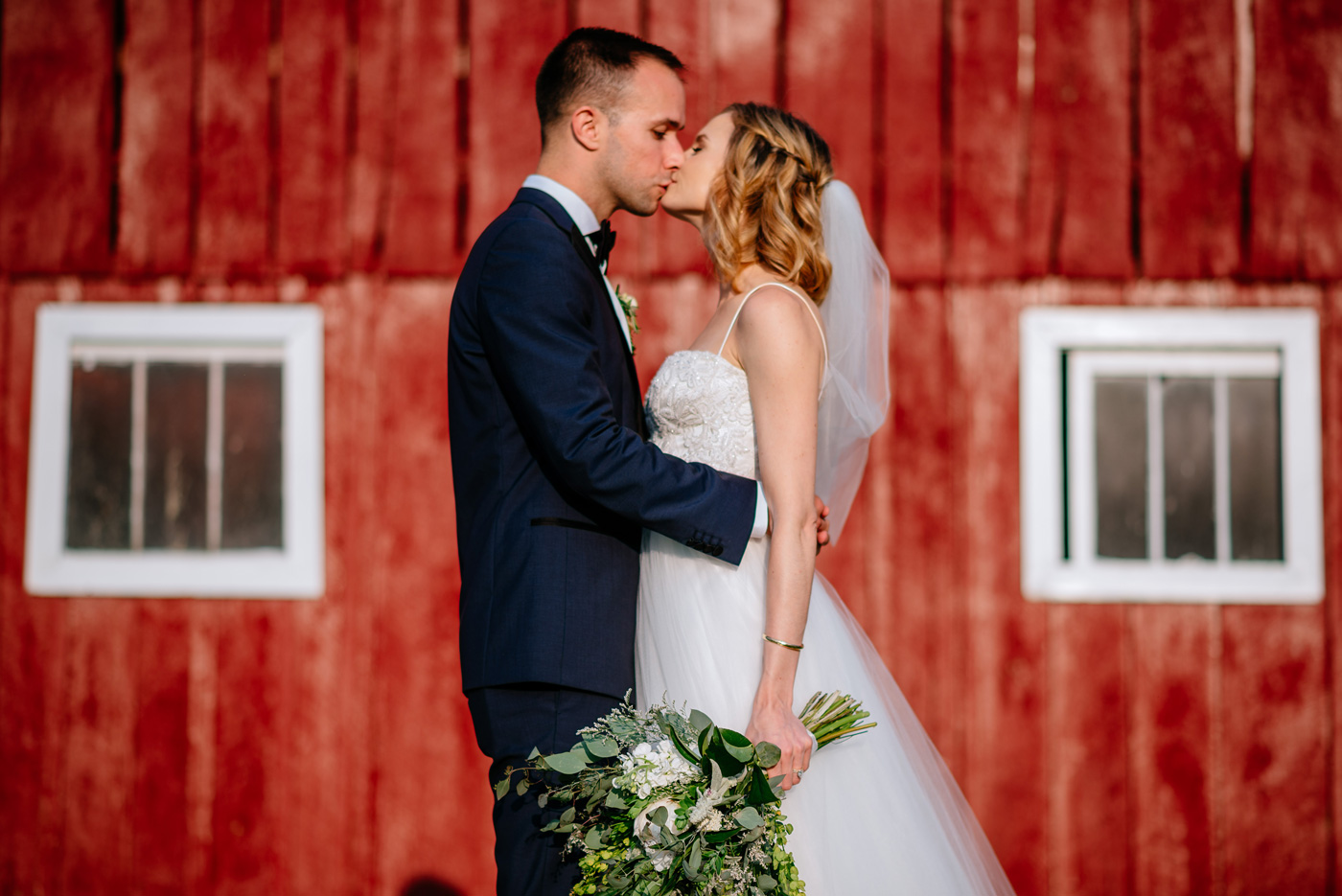 red barn bride and groom portrait