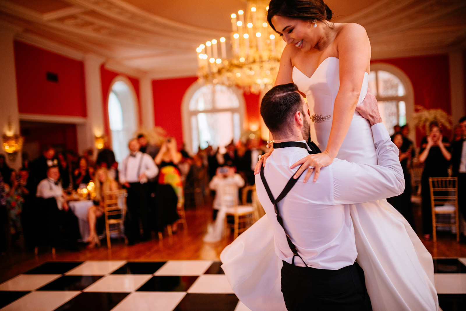 groom picking up bride during first dance greenbrier resort cameo ballroom wedding reception