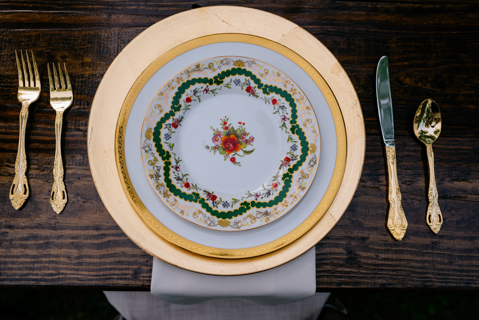 wedding details golden utensils vintage plates