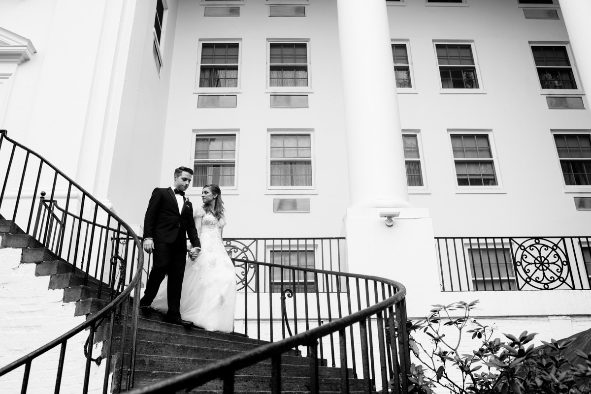 bride and groom walking down stairs at the greenbrier resort