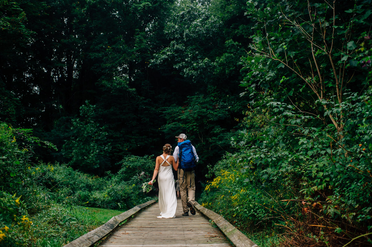bride groom just married long point trail rock climber hike wedding by unique wv photographers the oberports