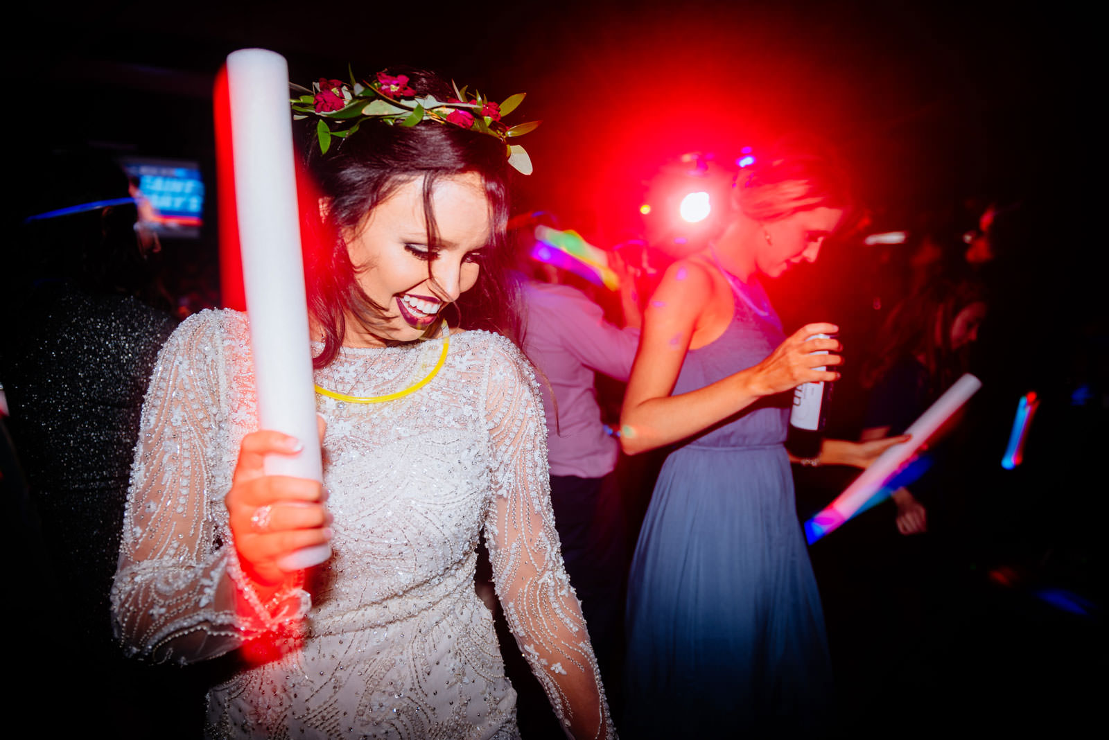 051bride waving glowstick during reception dancing