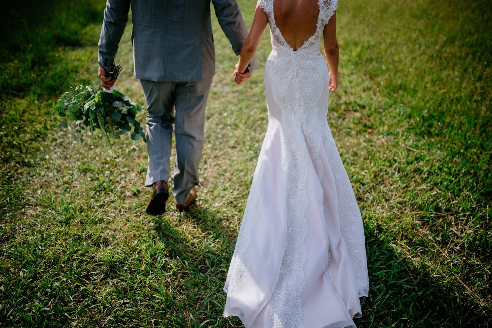 bride groom holding hands walking