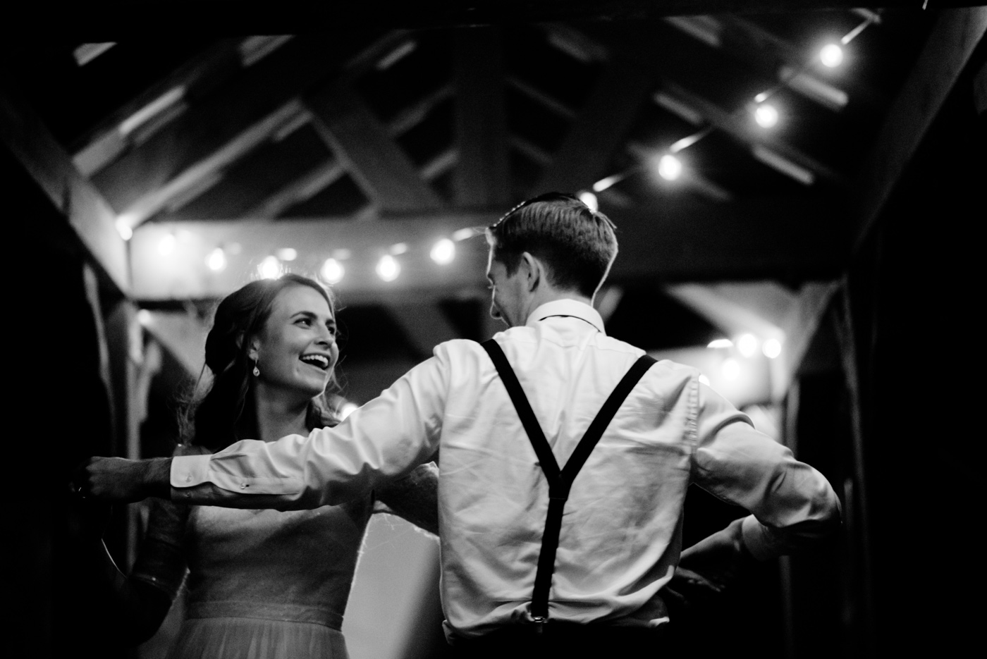 bride and groom dance alone at the end of the night