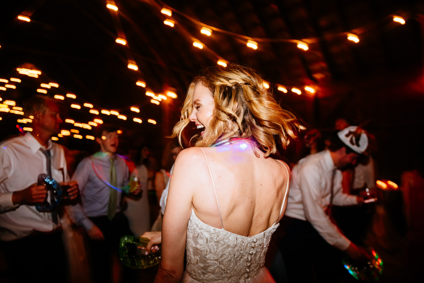 happy bride dancing at wedding reception