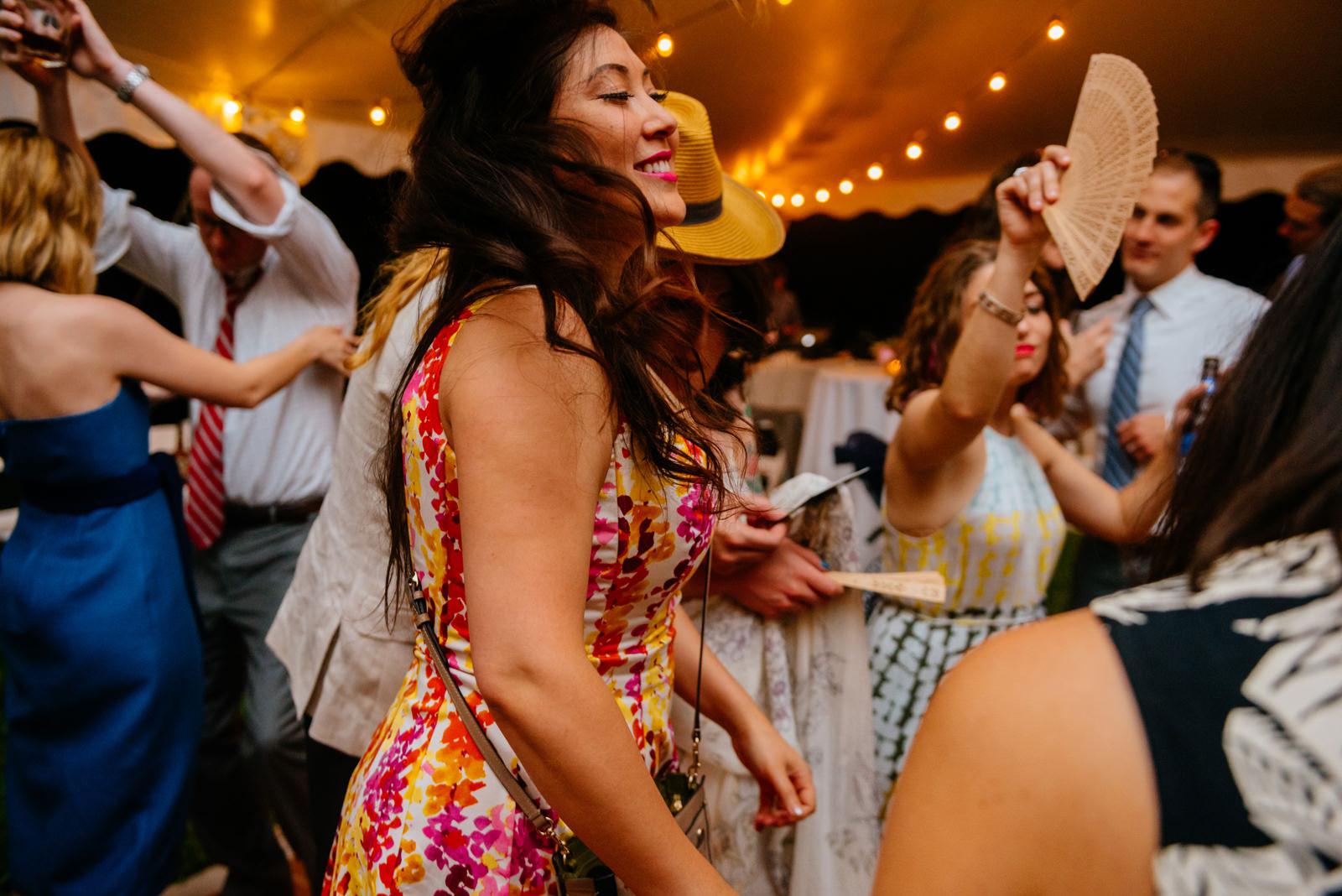 067b happy wedding guests dancing at reception