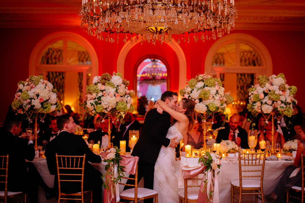 bride and groom embrace during wedding reception at the greenbrier resort