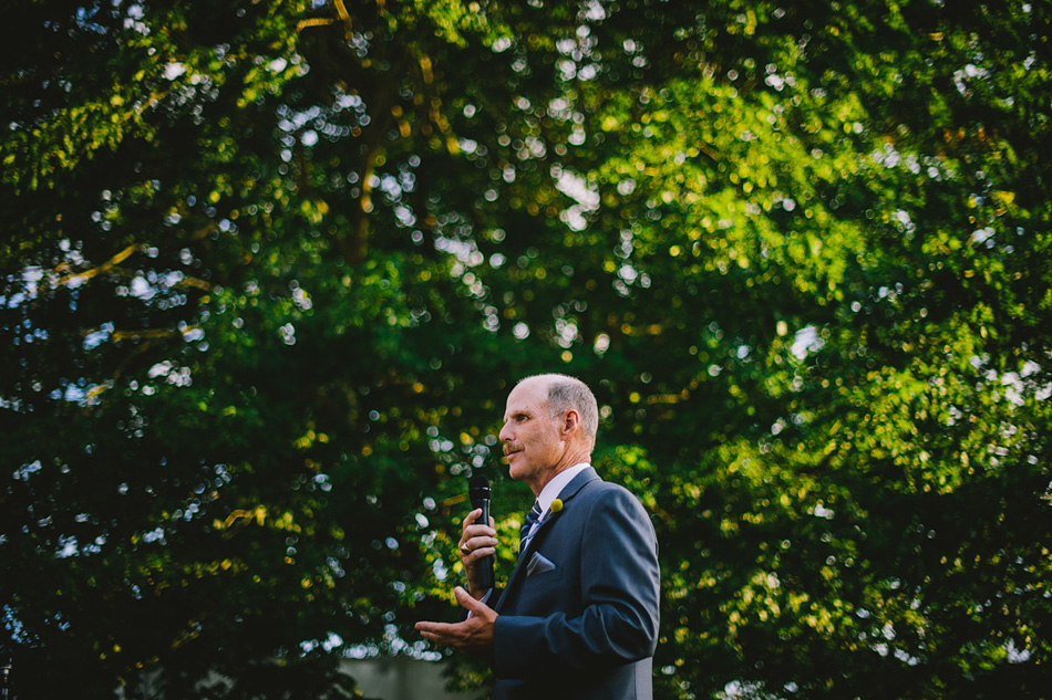outdoor wedding reception photo dad speech