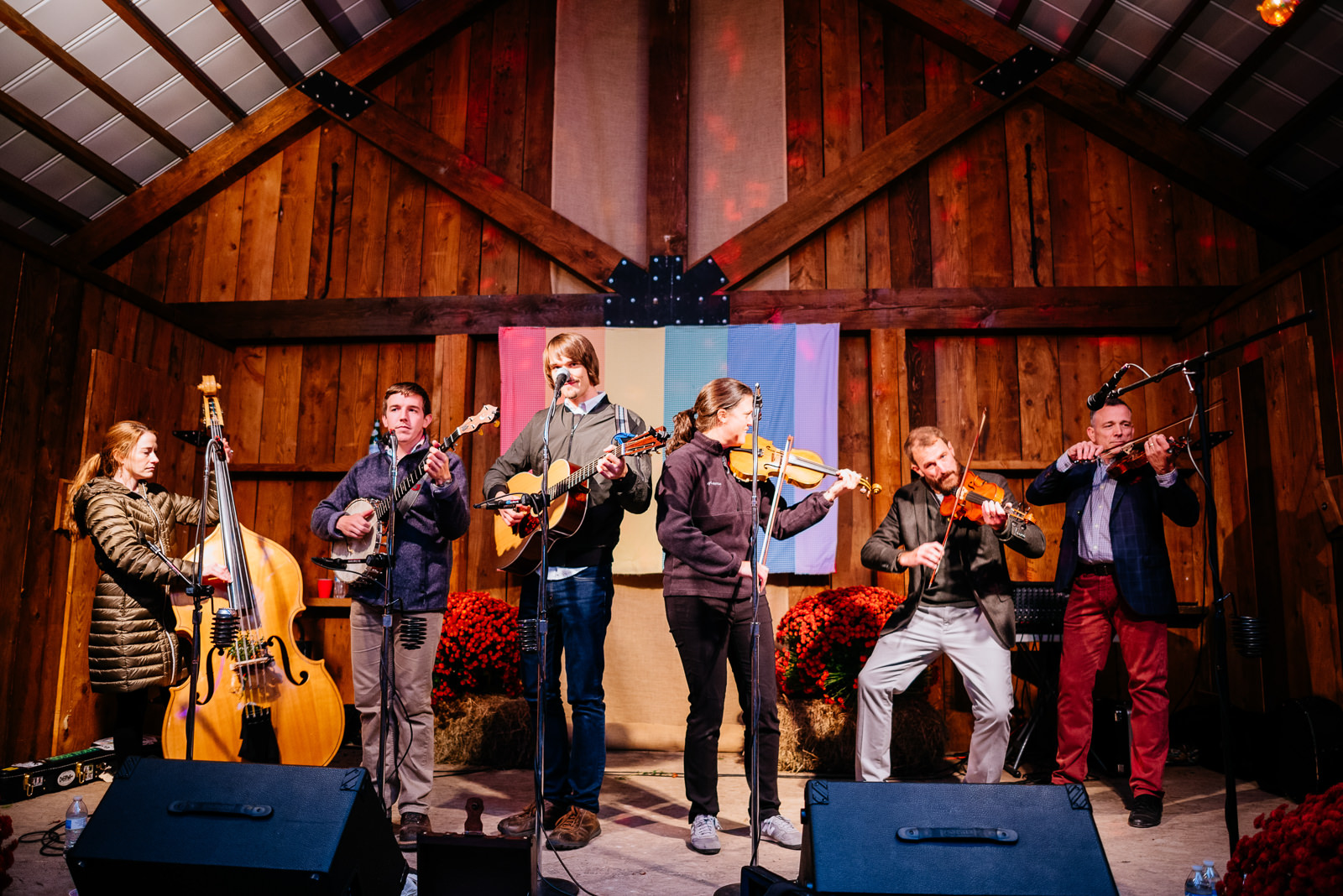 grooms playing fiddle with sam gleaves band wv farm wedding reception