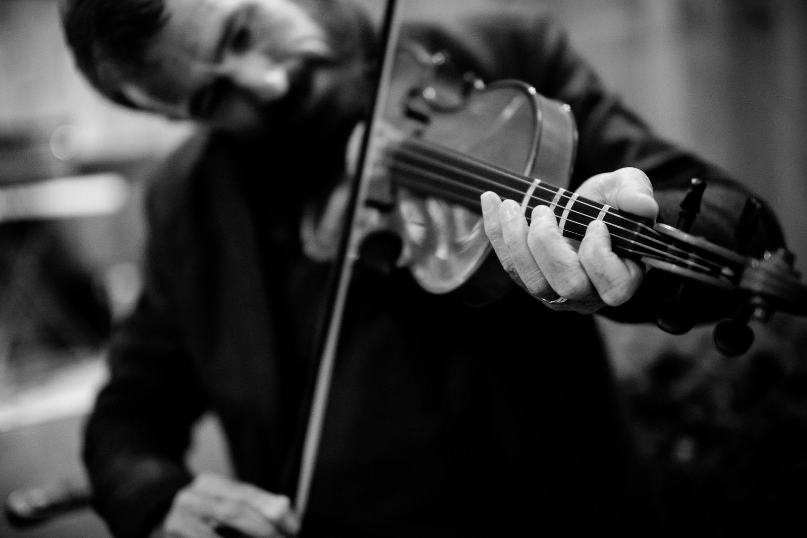 groom playing fiddle