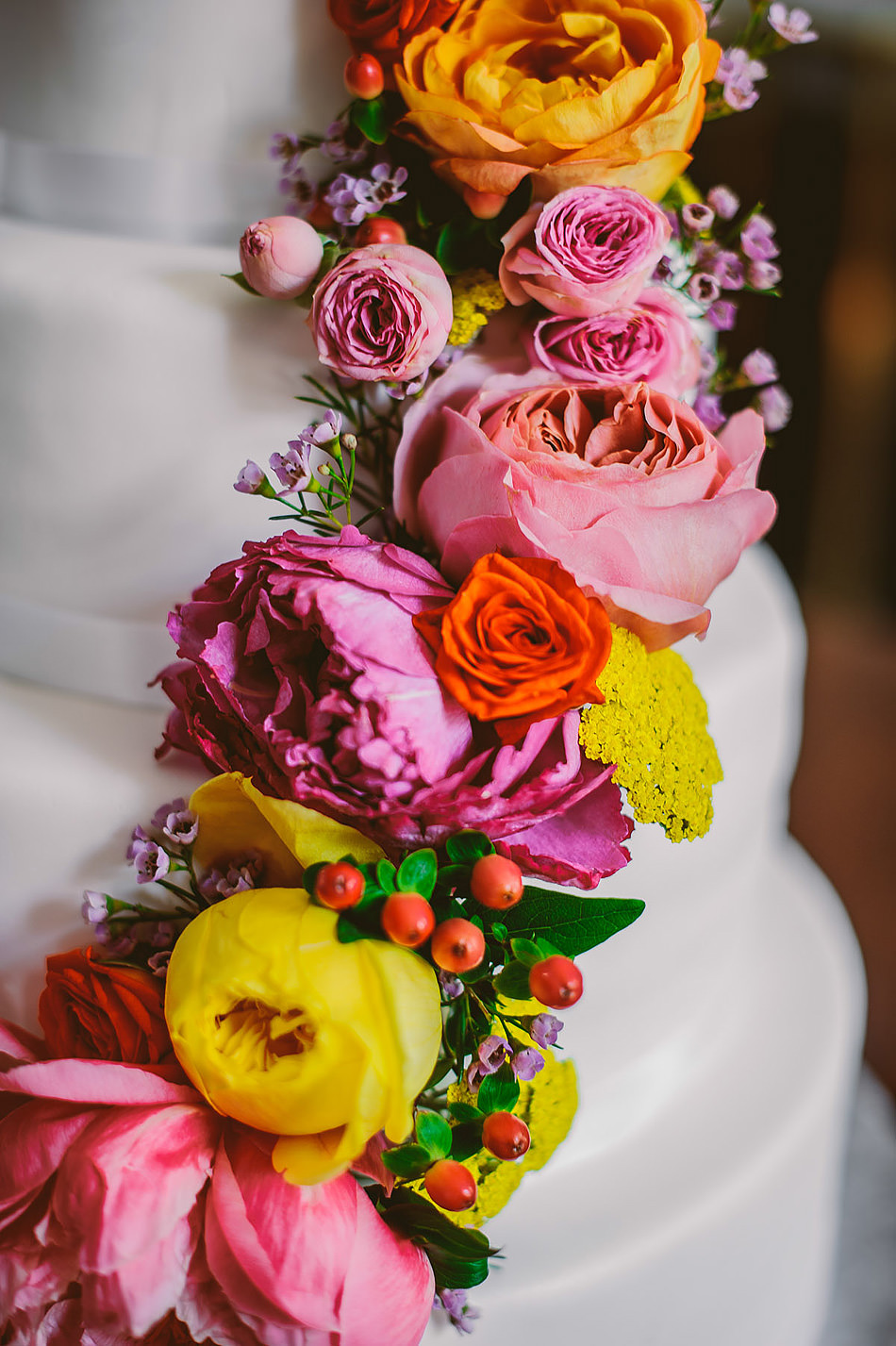 wedding cake with colorful cascading flowers1