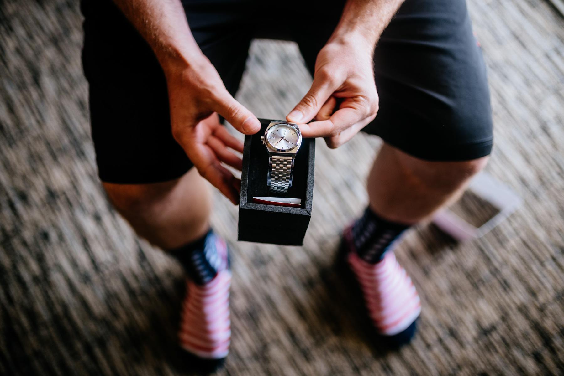 groom receives watch as gift