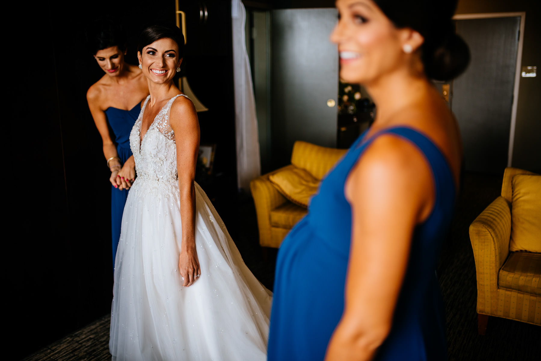 happy bride with sisters